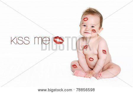 beautiful laughing baby boy sitting on white background