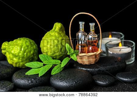 Aromatic Spa Concept Of Bergamot Fruits, Fresh  Mint, Candles And  Bottles Essential Oil In Basket O