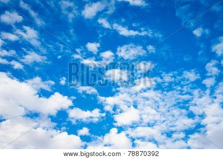 dramatic deep blue sky with streaky clouds