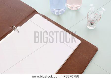 Empty paper binder on hospital desktop.