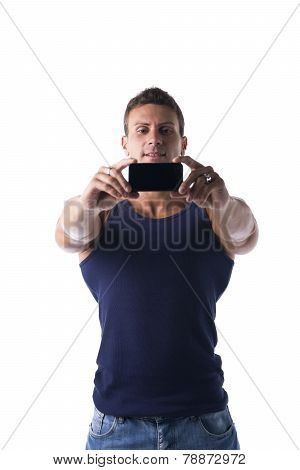 Handsome Muscular Young Man Taking Selfie With Cell Phone