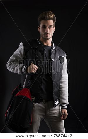 Close Up Gorgeous Man In Trendy Fashion Outfit Wearing University Jacket With Sport Bag