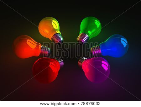 Multicolored Glowing Light Bulbs Lying On Dark