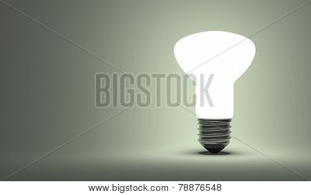 Shining Ellipsoidal Light Bulb On Gray