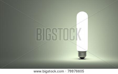 Shining Tubular Light Bulb On Gray