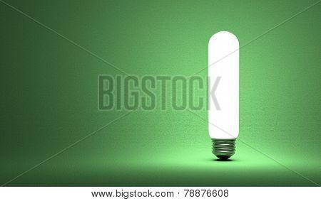 Shining Tubular Light Bulb On Green