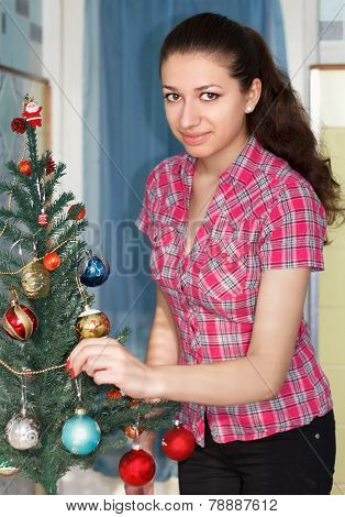 Beauty Girl Decorating Christmas Tree