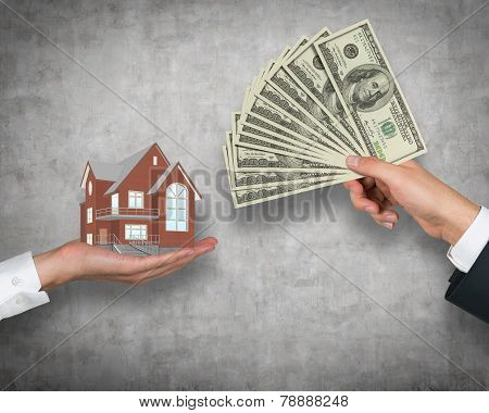 Hand Giving Money For Housing