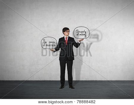 Businessman Holding Supply Of Money