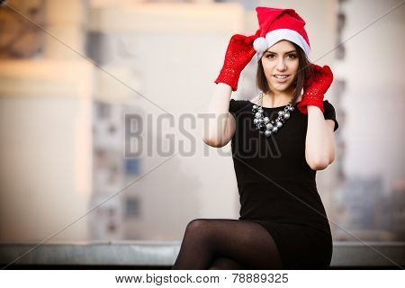 Christmas Santa hat outdoors woman portrait.Sexy seductive woman wearing her Santa hat