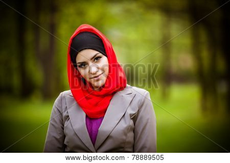 Beautiful muslim woman wearing hijab outdoor portrait