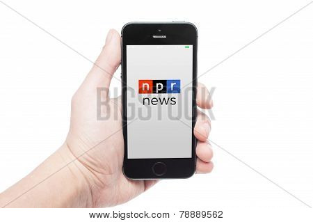 Photo Of A Hand Using Npr News App On Iphone 5S
