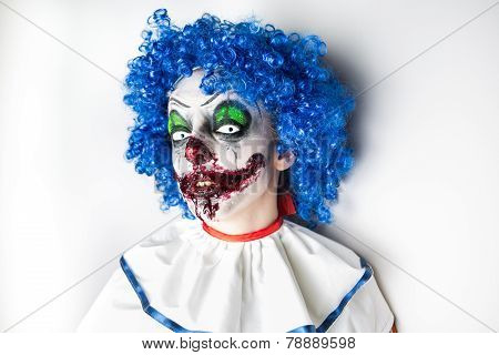 Crazy ugly grunge evil clown on Halloween. Scary professional Halloween masks