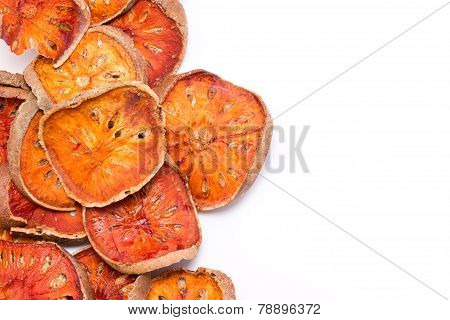 Slices Of Dried Bael Fruit Isolated On White.