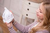 pic of expecting baby  - Closeup portrait of young attractive Caucasian woman holding baby hat - JPG