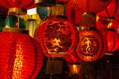 foto of blessed  - Focus on red Chinese lantern with the Chinese character Blessings written on it - JPG