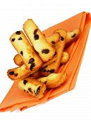 pic of baked raisin cookies  - Heap of Biscuit Raisin Cookies on Orange Napkin isolated on White background - JPG
