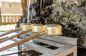 image of trough  - Brass dipper arranged in front of Purification trough in Shinto shrines and Buddhist temple Japan - JPG