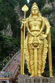 image of hindu-god  - Main attraction is the gold large statue of the Hindu God Batu Caves Temple in Kuala Lumpur Malaysia - JPG