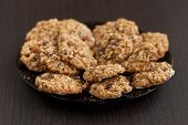 picture of baked raisin cookies  - oatmeal cookies with raisins on a plate on table - JPG