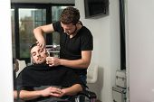 picture of beauty parlor  - Handsome Young Hairdresser Giving A New Haircut To Male Customer At Parlor  - JPG