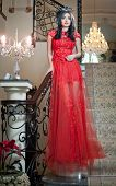 pic of wearing dress  - The beautiful girl in a long red dress posing in a vintage scene - JPG