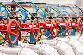 foto of pipeline  - detail of oil pipeline with valves in large oil refinery  - JPG