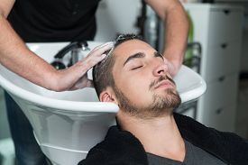 stock photo of beauty parlour  - Hairstylist Hairdresser Washing Customer Hair  - JPG