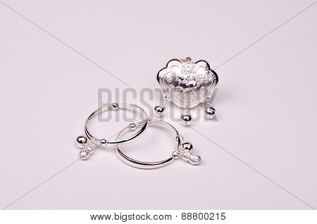 Silver Lock and Silver Bracelets on White Background