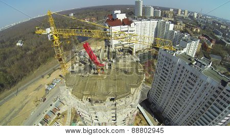 Construction of a new building in a residential area, aerial view