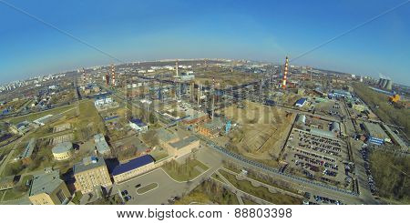 Cityscape with oil refinery in a sunny spring day, aerial view