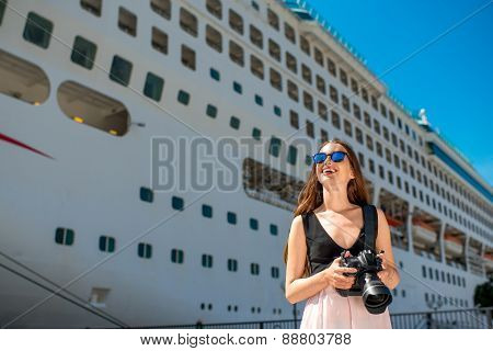 Woman tourist near the big cruise liner