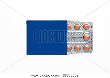 Blue box with brown pills blister pack