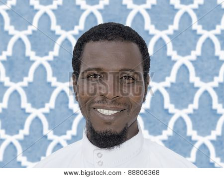 Portrait of an Afro man wearing a white djellaba