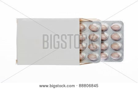 White box with brown pills blister pack