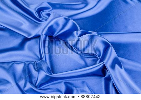 Blue silk drapery in shape of heart.