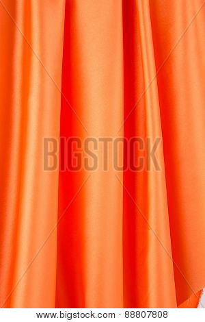 Orange silk drapery.