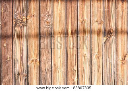 Wood slat with shadows.