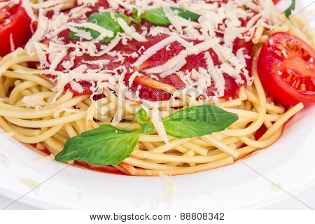 Pasta with tomato and basil.