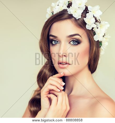 Beautiful girl with a wreath of flowers on her head.