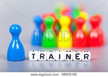 Cube Letters Show Trainer In Front Of Unsharp Figures
