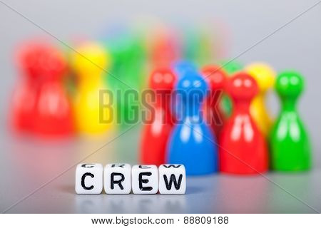 Cube Letters Show Crew  In Front Of Unsharp Figures