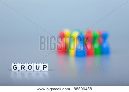 Cube Letters Show Group  In Front Of Unsharp Figures