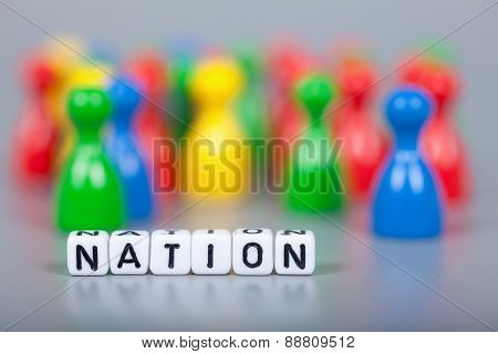 Cube Letters Show Nation  In Front Of Unsharp Figures