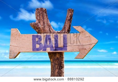 Bali wooden sign with beach background