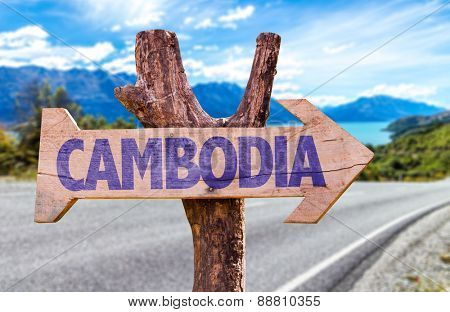 Cambodia wooden sign with road background