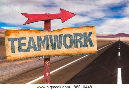 Teamwork sign with road background