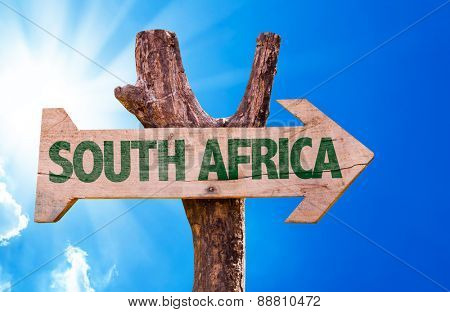 South Africa wooden sign with sky background