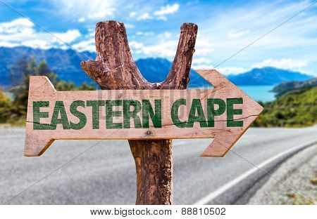 Eastern Cape wooden sign with road background
