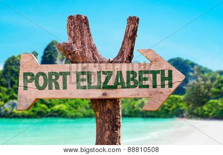 Port Elizabeth wooden sign with beach background
